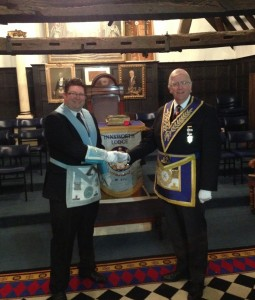 The Worshipful Master, WBro Andy Skelton congratulating WBro Peter Brindle Assistant Grand Sword Bearer