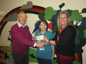 GMCA CHEQUE PRESENTED TO JAMES HOPKINS TRUST BY INNSWORTH LODGE (8751)