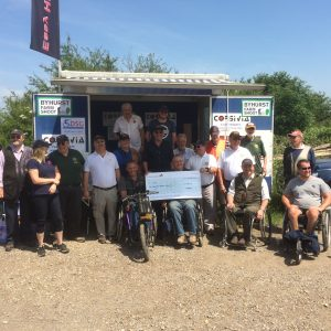 Clay shooting WM assists the presentation of a cheque from National Association of Masonic Clay Shooters to the British Disabled Shooting Group.